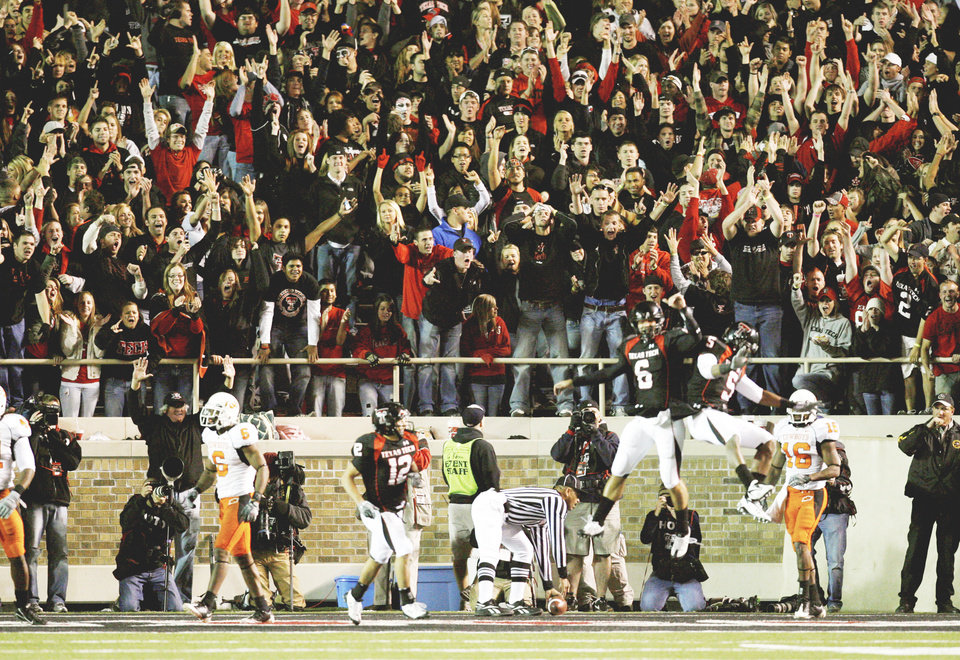Photo - Texas Tech's Graham Harrell, left, and receiver Michael Crabtree celebrate a touchdown pass during the second half of the Red Raiders' victory over the Cowboys on Nov. 8. Harrell has thrown for 4,077 yards and 36 touchdowns this season.Photo By Steve Sisney, The Oklahoman