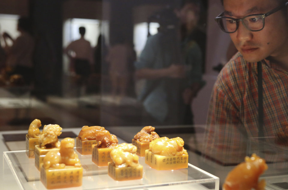 Photo - A man looks at the imperial stone seals with animal design knobs of Qing Dynasty displayed at the Tokyo National Museum in Tokyo during a press preview of the exhibition of