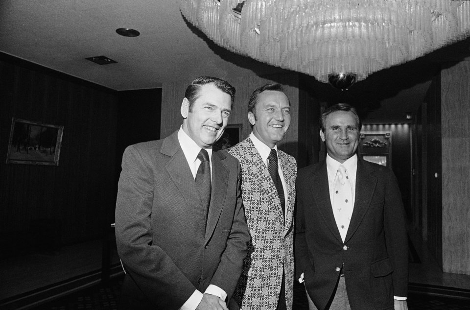 Photo - Miami Dolphin coach Don Shula, (right), was honored as the outstanding man in professional football at dinner in Boston on Sunday on May 21, 1973. He was named in balloting by some 1,500 guests at the annual New England Pro Football Dinner. George Allen, a nominee for the honor is at left. He is coach of the Washington Redskins. Chuck Fairbanks, New England Patriots coach, is man between them. Proceeds of dinner go to Boston Boys Clubs. (AP Photo)