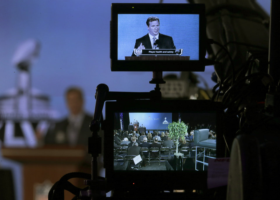 Photo - NFL Commissioner Roger Goodell is seen on a television monitor as he answers questions during an NFL Super Bowl XLVII football game news conference at the New Orleans Convention Center, Friday, Feb. 1, 2013. in New Orleans. (AP Photo/Charlie Riedel)