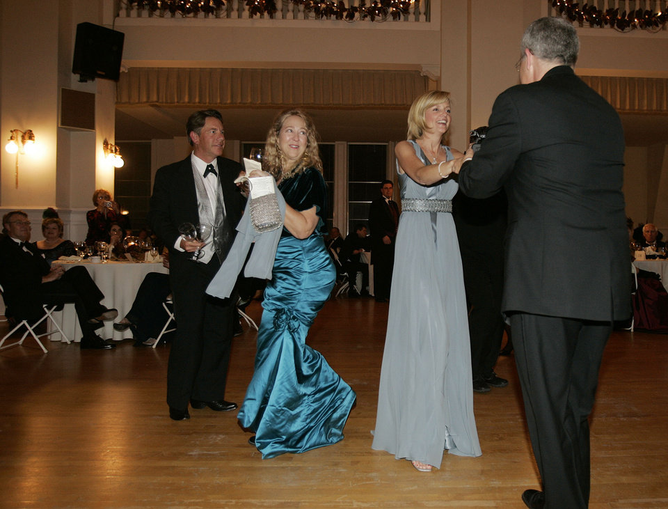 Photo - Rick and Jenny Dunning of Oklahoma City, left, join Oklahoma First Lady Kim Henry and Gov. Brad Henry, right, on the dance floor at the Oklahoma Centennial Statehood Inaugural Ball, Saturday, Nov. 17, 2007, at the Guthrie Scottish Rite Masonic Center, in Guthrie, Okla. By Bill Waugh, The Oklahoman