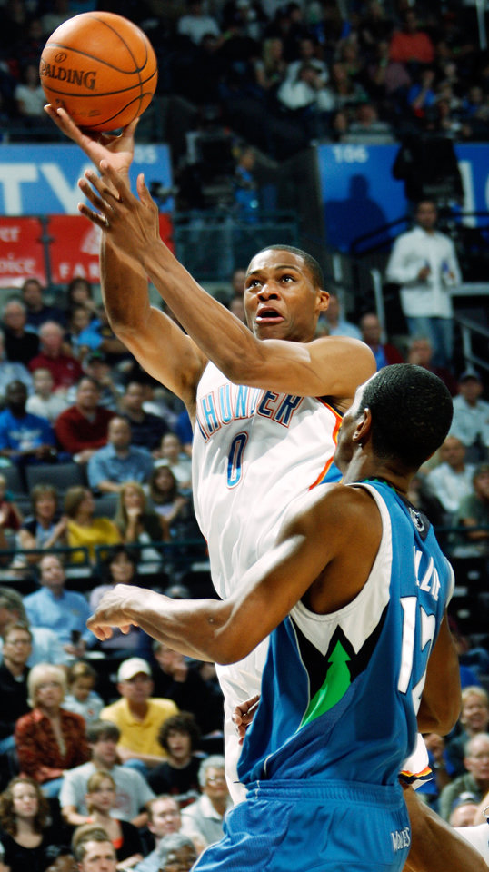 Photo - FIRST REGULAR SEASON WIN: Oklahoma City's Russell Westbrook takes a shot over Kevin Ollie of Minnesota during the NBA basketball game between the Oklahoma City Thunder and the Minnesota Timberwolves at the Ford Center in Oklahoma City, Sunday, Nov. 2, 2008. BY NATE BILLINGS, THE OKLAHOMAN  ORG XMIT: KOD