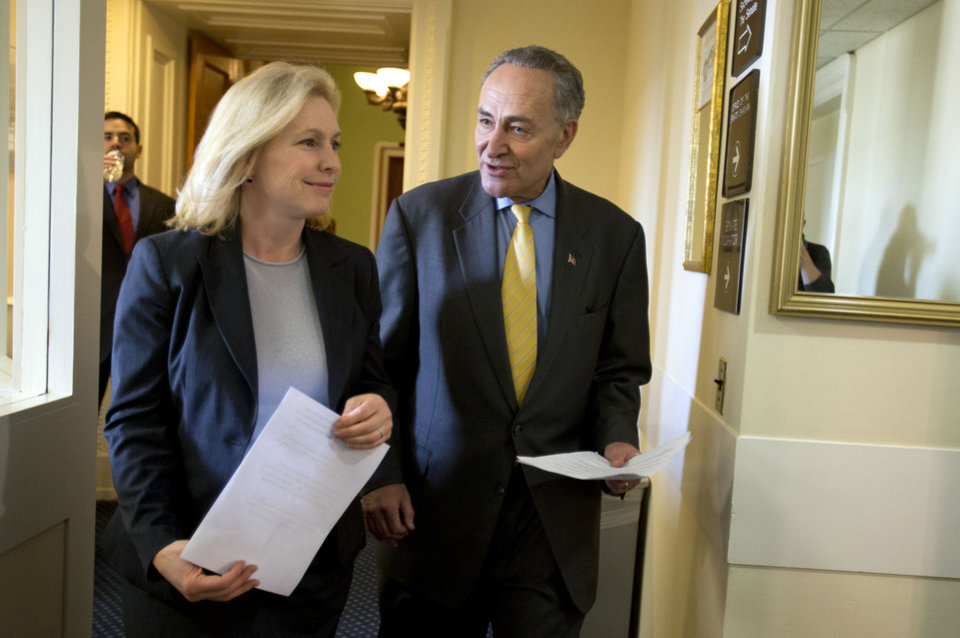 FILE - In this Jan. 4, 2013, file photo, Sen. Charles Schumer, D-N.Y., right, accompanied by Sen. Kirsten Gillibrand, D-N.Y, enter a news conference on Capitol Hill in Washington, to discuss Superstorm Sandy aid. Conservatives and watchdog groups are mounting a