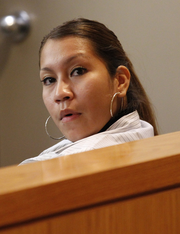 Elizabeth Escalona, 23, sits in a courtroom to be sentenced, in Dallas, Monday, Oct. 8, 2012. Escalona pleaded guilty on July 12, 2012, to injury to a child and is facing up to life in prison. A doctor has testified that the Texas mother glued her 2-year-old daughter\'s hands to a wall and beat the toddler so badly that she suffered significant brain trauma and bleeding inside her skull. (AP Photo/LM Otero)