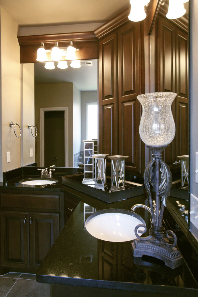 Photo - Dual vanities are features of the master bath in the Rice Homes custom at 19517 Fieldshire Drive. Photo by Jim Beckel, THE OKLAHOMAN