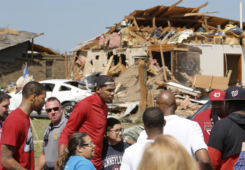 Oklahoma City Thunder\'s Kevin Durant toured a southwest Oklahoma City neighborhood that took a direct hit in last Monday\'s F5 tornado to offer words of support and encouragement to homeowners and volunteers assisting with the relief effort. Durant walked several blocks along S. Hudson, near SW 145, on Wednesday afternoon, May 22, 2013, and also visited Briarwood School, the heavily damaged elementary school in the same neighborhood. Photo by Jim Beckel, The Oklahoman.