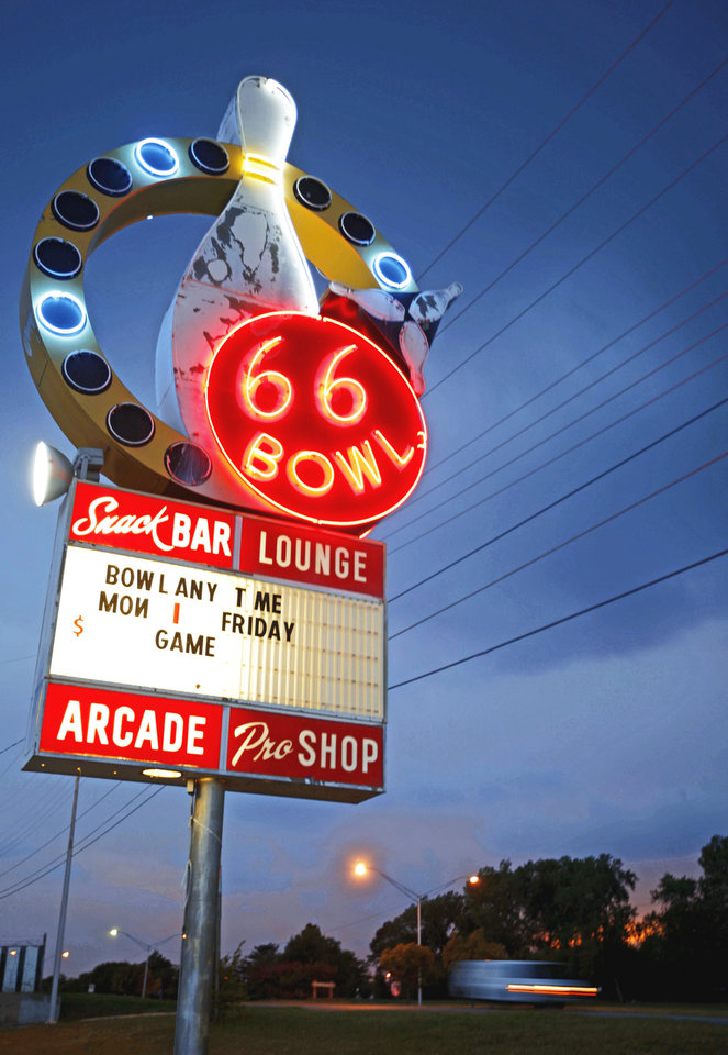 Photo - An original, 50-year-old neon sign is lit outside 66 Bowl, 3810 NW 39, in Oklahoma City. PHOTOS BY BRYAN TERRY, THE OKLAHOMAN