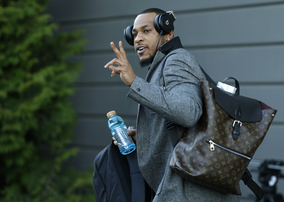 Photo - Seattle Seahawks wide receiver Percy Harvin leaves team headquarters in Renton, Wash., Sunday, Jan. 26, 2014, to board a bus for his flight to play the Denver Broncos in the NFL Super Bowl XLVIII football game in East Rutherford, N.J. (AP Photo/Ted S. Warren)
