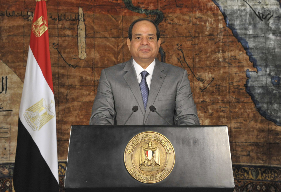 """Photo - This image released by Egypt's official Middle East News Agency (MENA), shows Egyptian President Abdel-Fattah el-Sissi during a nationally televised broadcast in Cairo, Egypt, Monday, July 7, 2014. El-Sissi has defended his recent decisions to partially lift subsidies on fuel, calling them a necessary """"bitter pill"""" and he couldn't delay such decisions even if it cost him support because """"the dangers are great"""" for Egypt's economy. He urged Egyptians to bear the austerity measures and appealed to the rich to donate to Egypt's development. Likening the current conditions to times of wars with Israel, el-Sissi said Egypt is at war to rebuild following turmoil. (AP Photo/Ahmed Fouad, MENA)"""