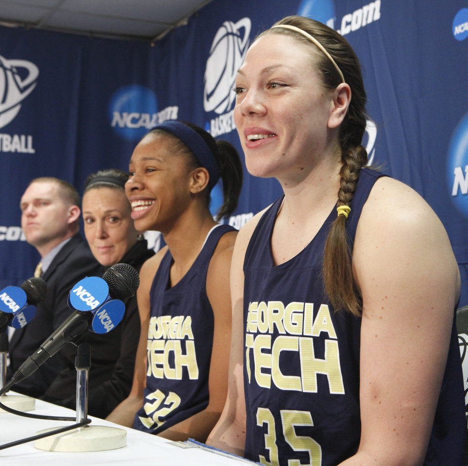 Photo - WOMEN'S NCAA TOURNAMENT / WOMEN'S COLLEGE BASKETBALL / NORMAN REGIONAL: Georgia Tech University player Brigitte Ardossi speaks during a press conference at the 2010 NCAA Division 1 Women's Basketball Championship first and second round tournament at the Lloyd Noble Center on Saturday, March 20, 2010, in Norman, Okla.  At left are head coach MaChelle Joseph and player Alex Montogomery.   Photo by Steve Sisney, The Oklahoman ORG XMIT: KOD