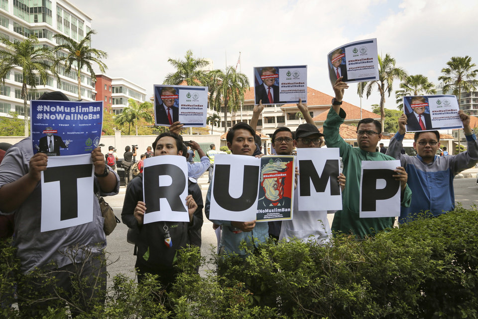 Photo - Muslim protesters demonstrate against U.S. President Trump's immigration ban outside U.S. Embassy in Kuala Lumpur, Malaysia, on Friday, Feb. 3, 2017. Trump's order temporarily halted the entire U.S. refugee program and banned all entries from seven Muslim-majority nations for 90 days. (AP Photo/Vincent Thian)