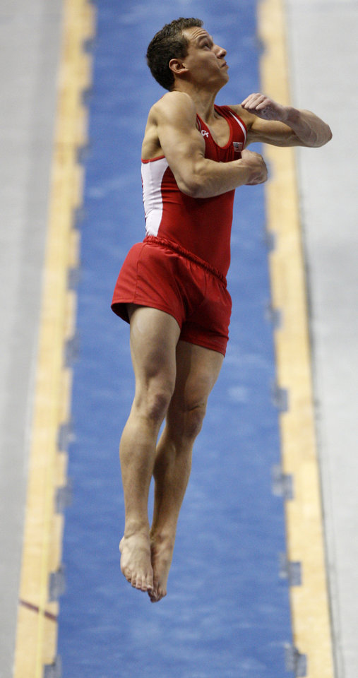 Photo - Oklahoma's Dylan Akers competes on the vault during the men's NCAA college gymnastics championships in at the Lloyd Noble Center in Norman, Okla., Thursday, April19, 2012. Photo by Bryan Terry, The Oklahoman