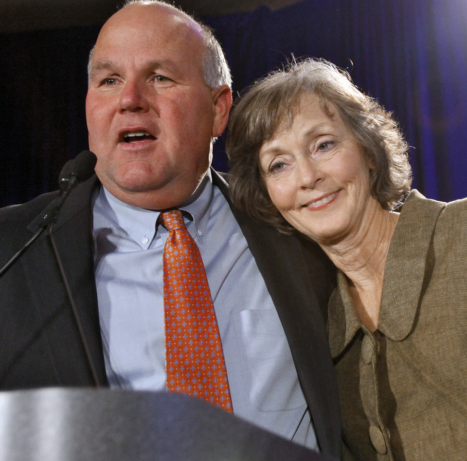 Photo - State auditor and inspector elect Gary Jones is hugged by his wife Mary Jane while he talks to supporters at the republican Watch Party at the Marriott on Tuesday, Nov. 2, 2010, in Oklahoma City, Okla.   Photo by Chris Landsberger, The Oklahoman