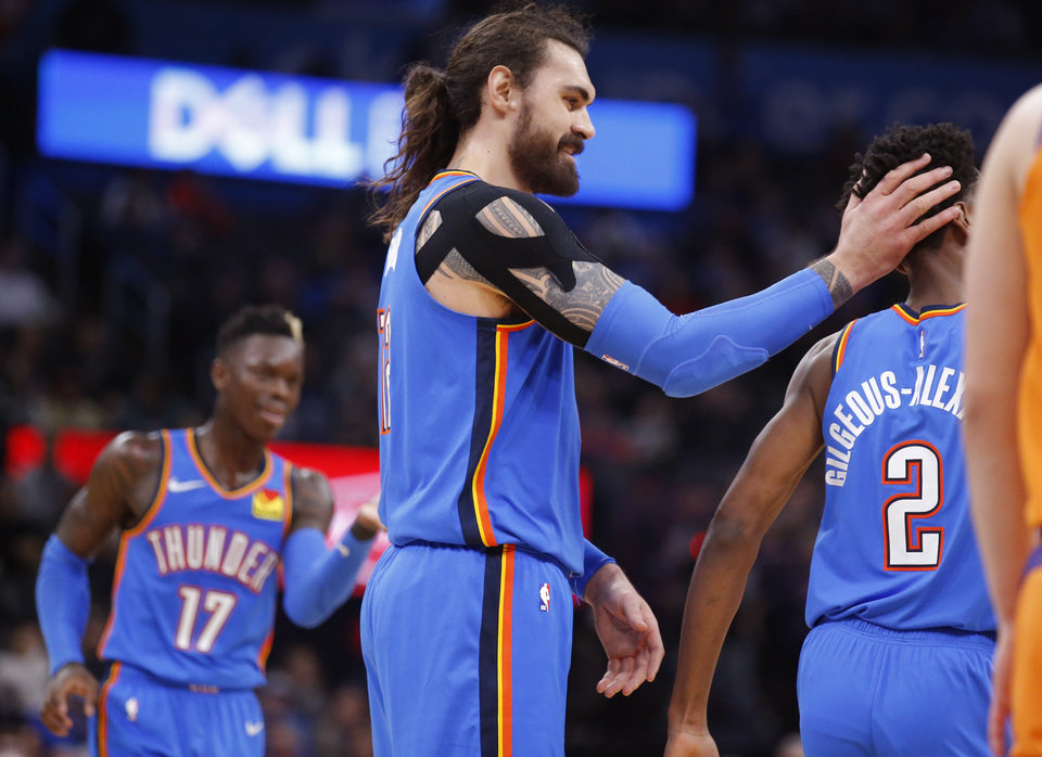 Photo - Steven Adams (12) celebrates with Shai Gilgeous-Alexander (2) during the NBA basketball game between the Oklahoma City Thunder and the Phoenix Suns at the Chesapeake Energy Arena in Oklahoma City , Friday, Dec. 20, 2019.   [Sarah Phipps/The Oklahoman]