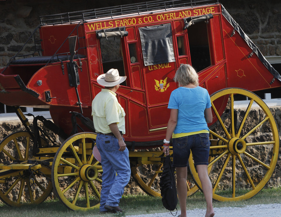 Visitors to the Pawnee Bill Ranch and Museum look at the stagecoach that will be part of the Pawnee Bill Wild West Show in Pawnee, Oklahoma on Saturday,  June 23, 2012.  Photo by Jim Beckel, The Oklahoman