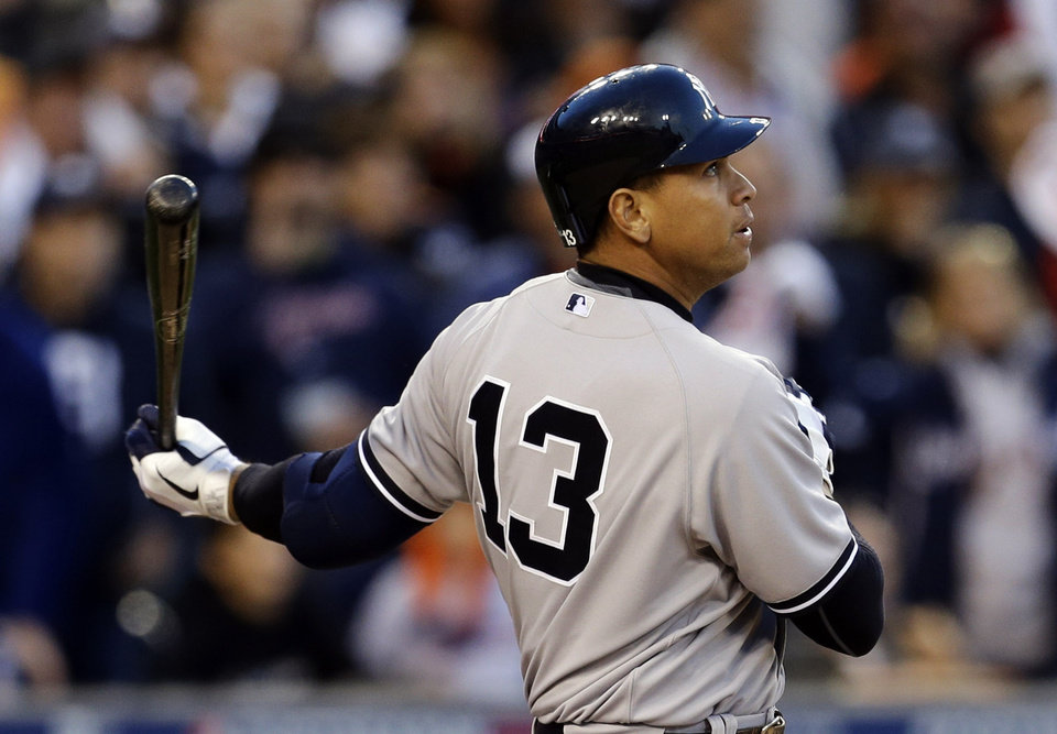 Photo -   New York Yankees' Alex Rodriguez watches as he flies out in the sixth inning during Game 4 of the American League championship series against the Detroit Tigers Thursday, Oct. 18, 2012, in Detroit. (AP Photo/Paul Sancya )