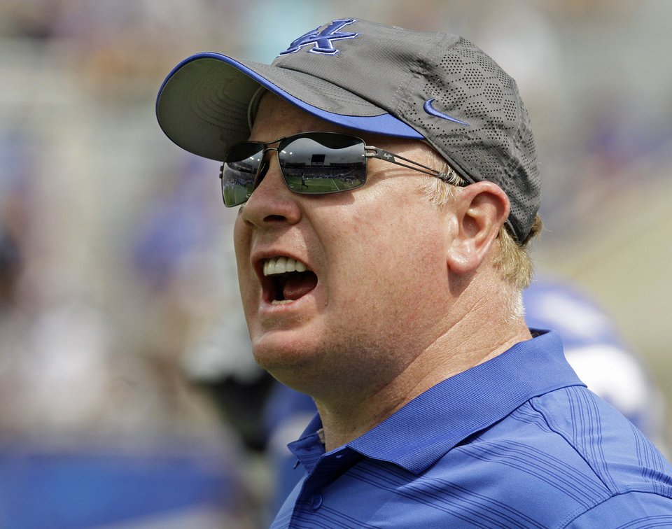 Photo - Kentucky football coach Mark Stoops shouts instructions to his team during an NCAA college football game against Tennessee-Martin in Lexington, Ky., Saturday, Aug. 30, 2014. Kentucky beat Tennessee-Martin 59-14. (AP Photo/Garry Jones)