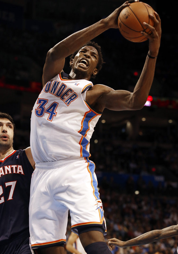 Oklahoma City Thunder\'s Hasheem Thabeet (34) rebounds in front of Atlanta Hawk\'s Zaza Pachulia (27) as the Oklahoma City Thunder play the Atlanta Hawks in NBA basketball at the Chesapeake Energy Arena in Oklahoma City, on Sunday, Nov. 4, 2012. Photo by Steve Sisney, The Oklahoman
