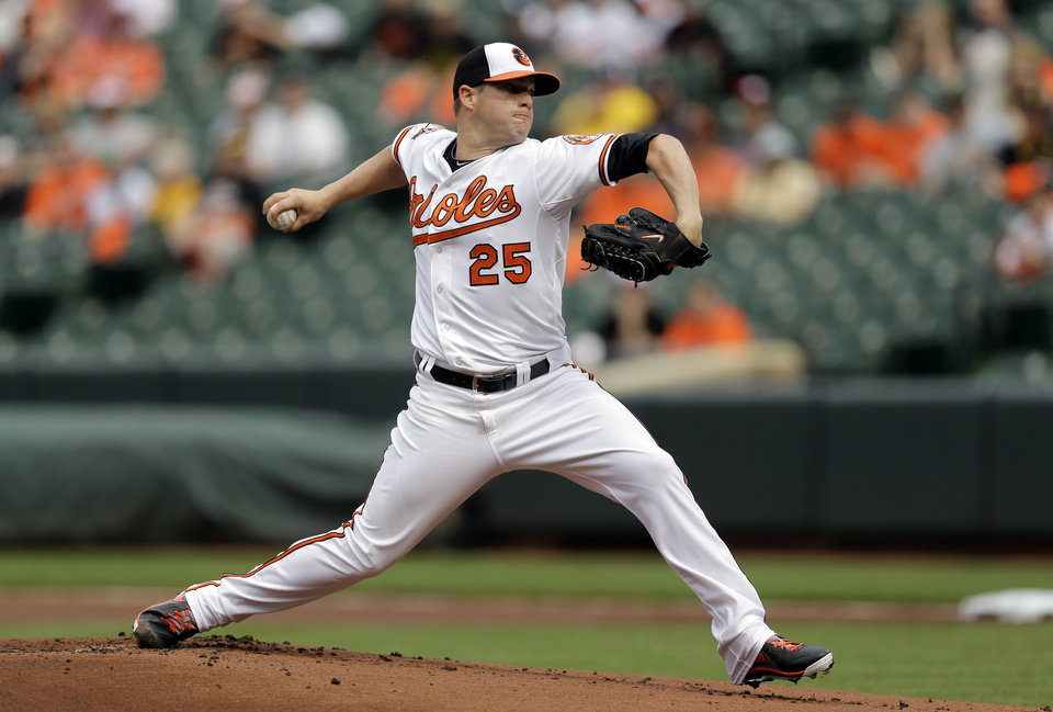 Photo - Baltimore Orioles starting pitcher Bud Norris throws to the Pittsburgh Pirates in the first inning in the first baseball game of a doubleheader on Thursday, May 1, 2014, in Baltimore. (AP Photo/Patrick Semansky)