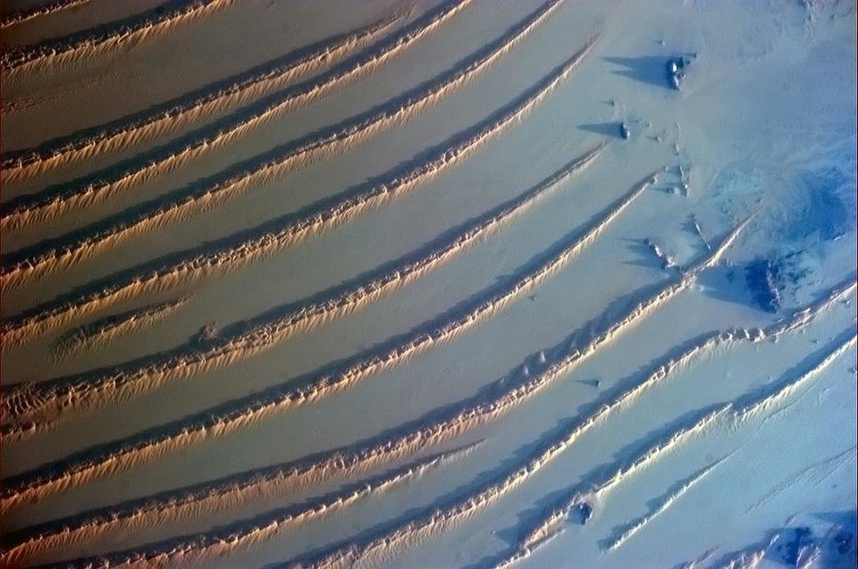 """If you give wind and sand enough time together, they create art,"" writes Canadian astronaut Col. Chris Hadfield about this photo he took from the International Space Station and shared on Facebook. <strong></strong>"