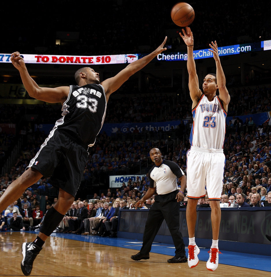 Oklahoma City's Kevin Martin (23) shoots against San Antonio's Boris Diaw (33) during an NBA basketball game between the Oklahoma City Thunder and the San Antonio Spurs in Oklahoma City Monday, Dec. 17, 2012. Oklahoma City won, 107-93. Photo by Nate Billings, The Oklahoman