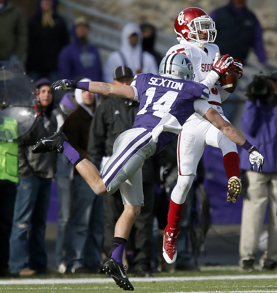 Oklahoma's Zack Sanchez (15) intercepts a pass intended for Kansas State's Curry Sexton (14) before returning it for a touchdown during an NCAA college football game between the Oklahoma Sooners and the Kansas State University Wildcats at Bill Snyder Family Stadium in Manhattan, Kan., Saturday, Nov. 23, 2013. Oklahoma won 41-31. Photo by Bryan Terry, The Oklahoman
