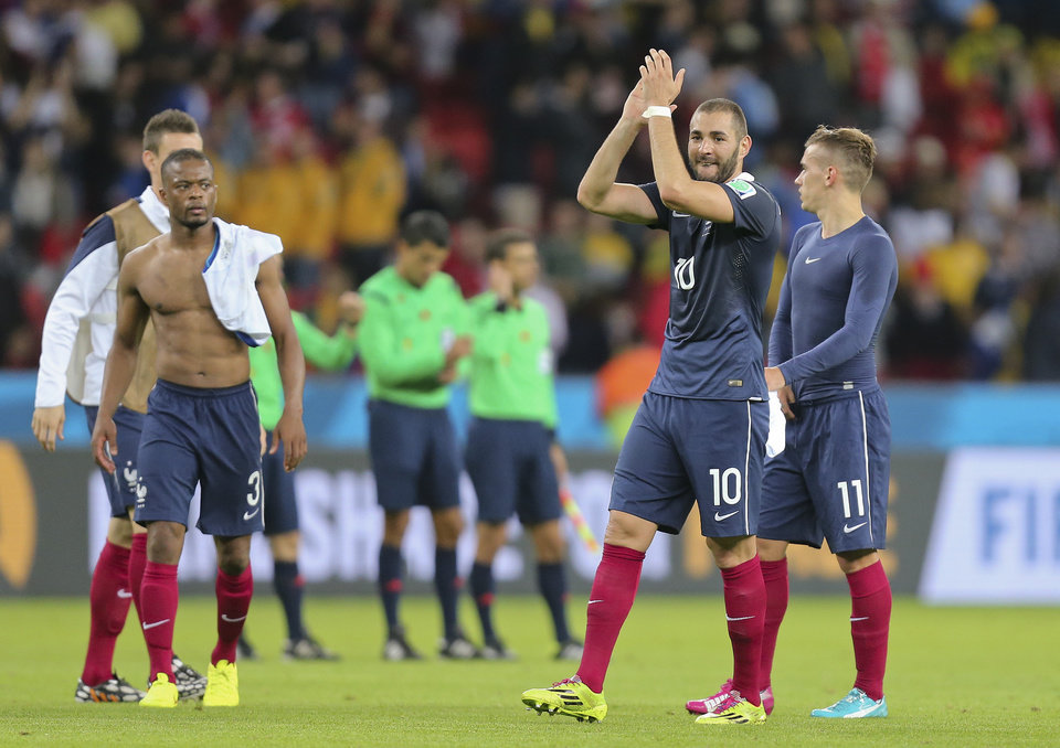 Photo - France's Karim Benzema applauds as he leaves the field at the end of the group E World Cup soccer match between France and Honduras at the Estadio Beira-Rio in Porto Alegre, Brazil, Sunday, June 15, 2014. France won the match 3-0. (AP Photo/David Vincent)