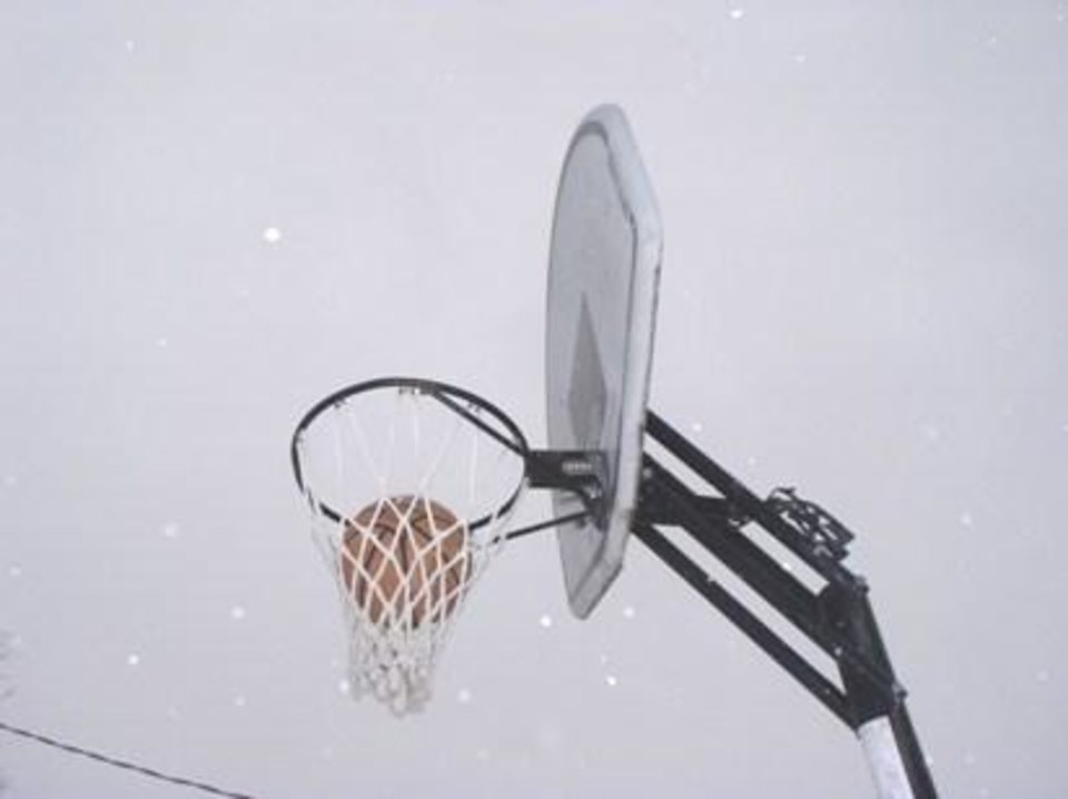basketball frozen in the basket<br/><b>Community Photo By:</b> Gayle Campbell<br/><b>Submitted By:</b> Dan, Harrah