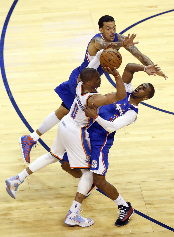 Oklahoma City's Russell Westbrook (0) is defended by Chris Paul (3) and Matt Barnes during Game 2 of the Western Conference semifinals in the NBA playoffs between the Oklahoma City Thunder and the Los Angeles Clippers at Chesapeake Energy Arena in Oklahoma City, Wednesday, May 7, 2014. Photo by Sarah Phipps, The Oklahoman