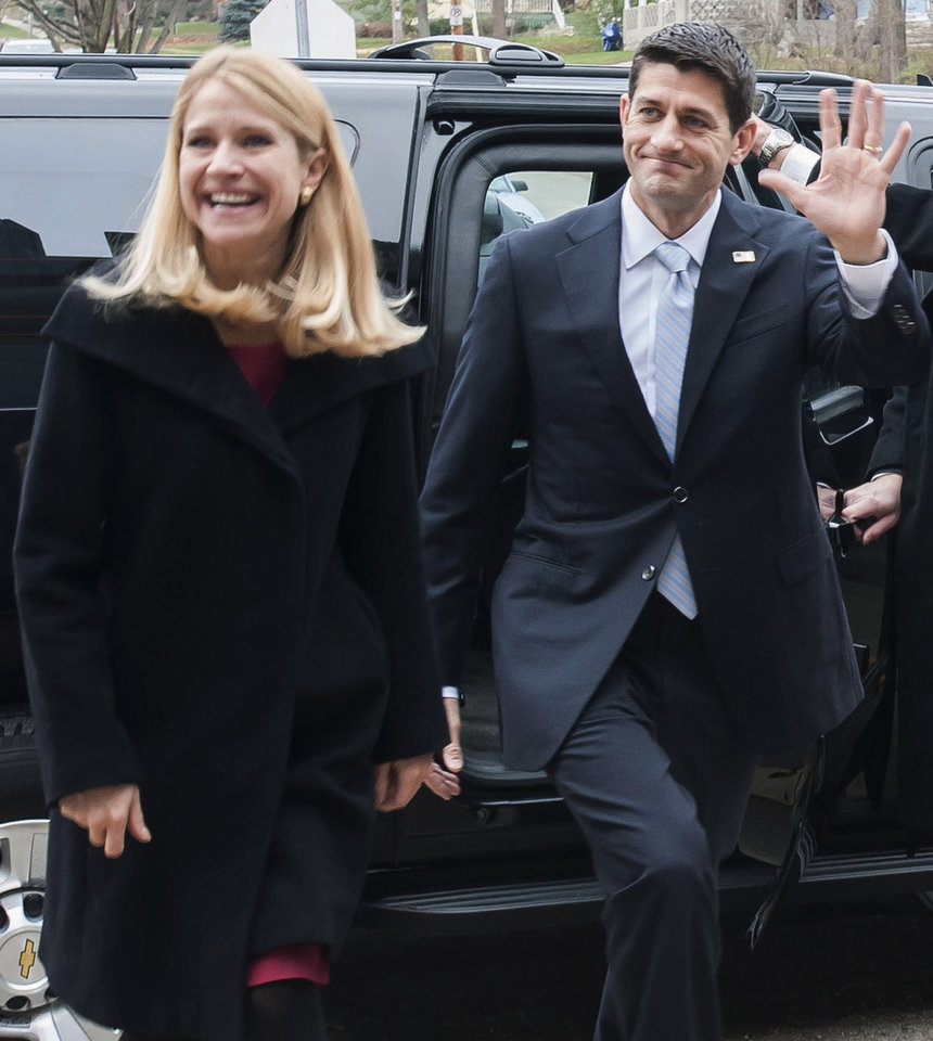 Rep. Paul Ryan, Republican vice presidential nominee, and his wife Janna Ryan, arrive to vote at the Hedberg Public Library in Ryan's hometown of Janesville, Wis. on Tuesday, Nov. 6, 2012. (AP Photo/The Janesville Gazette, Mark Kauzlarich)