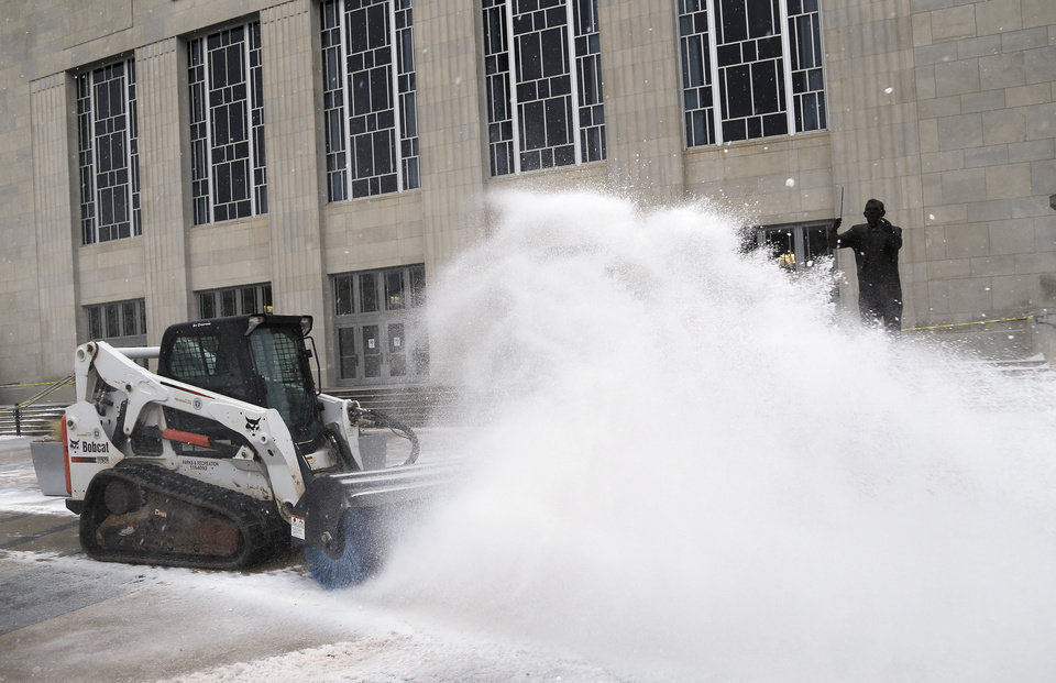 Oklahoma City workers clear snow from Civic Center Thursday, December 5, 2013.  Photo by Doug Hoke, The Oklahoman