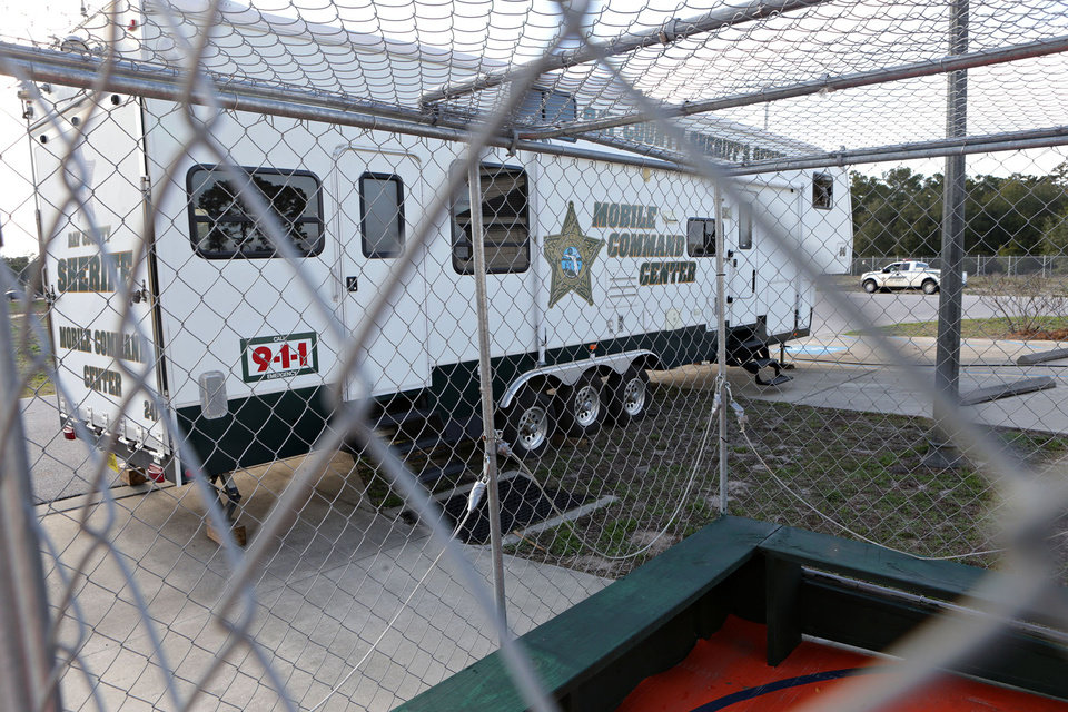Photo - FILE - This March 5, 2014 file photo shows the Bay County Sheriff's Office Mobile Command Center through one of several containment units in Panama City Beach, Fla., a popular travel location for spring break revelers. (AP Photo/The News Herald/Panama City, Fla., Heather Leiphart)