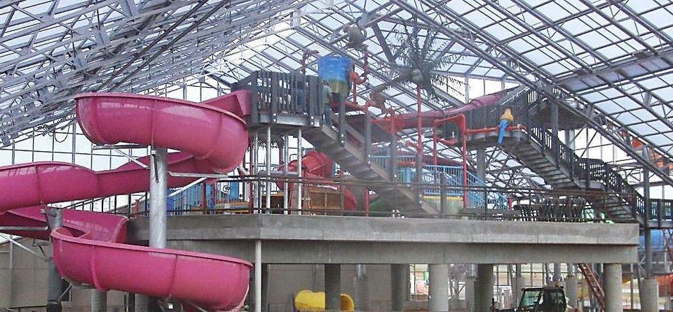Photo - Water slides and a tipping bucket are shown inside the Water Zoo, an indoor water park opening in September in Clinton.  PHOTOS PROVIDED