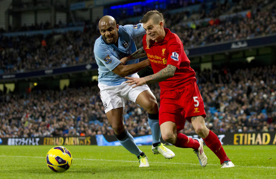 Manchester City's Maicon, left, fights for the ball against Liverpool's Daniel Agger during their English Premier League soccer match at The Etihad Stadium, Manchester, England, Sunday Feb. 3, 2013. (AP Photo/Jon Super)