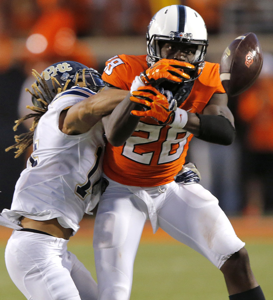 Photo - Pittsburgh's Avonte Maddox (14) breaks up a pass for Oklahoma State's James Washington (28) during a college football game between the Oklahoma State Cowboys (OSU) and the Pitt Panthers at Boone Pickens Stadium in Stillwater, Okla., Saturday, Sept. 17, 2016. Photo by Chris Landsberger, The Oklahoman