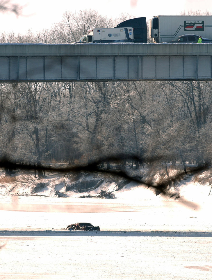 Photo - Pickup truck slides off the Spring River Bridge on the Will Rogers Turnpike in Ottawa County. Gary Crow, for the Oklahoman