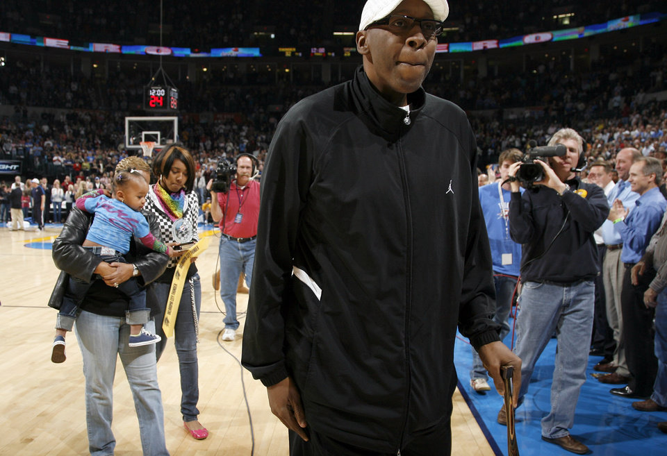 Photo - DEATH / DIED FRIDAY, MAY 15, 2009 / MUSICIAN / FORMER UNIVERSITY OF OKLAHOMA (OU) COLLEGE BASKETBALL / FORMER NBA BASKETBALL PLAYER / HONOR: Wayman Tisdale walks off the court after receiving the Thunder Community Hero award during the NBA game between Oklahoma City Thunder and San Antonio Spurs, Tuesday April 7, 2009, at the Ford Center in  Oklahoma CIty. Photo by Sarah Phipps, The Oklahoma ORG XMIT: KOD