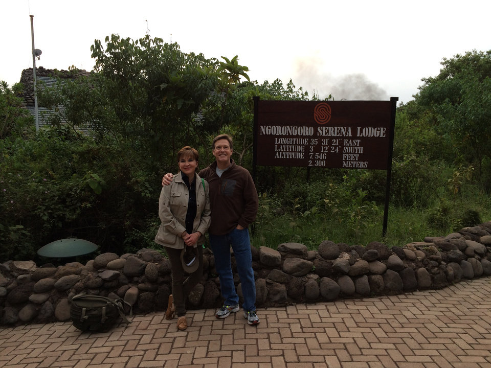 Photo -  Lori and Wes Lane pose for a photo outside the Ngorongoro Serena Lodge in The Ngorongoro Highlands, while on a photo safari in Africa. Photos provided