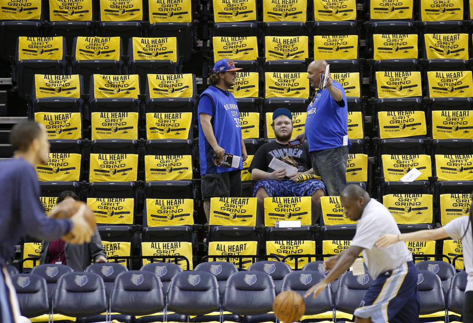 Photo - Jacob Akin, left, Chandler Weir, and his father Kurt Weir, from Jonesboro, Ark., wait for the start of Game 6  in the first round of the NBA playoffs between the Oklahoma City Thunder and the Memphis Grizzlies at FedExForum in Memphis, Tenn., Thursday, May 1, 2014. Photo by Bryan Terry, The Oklahoman