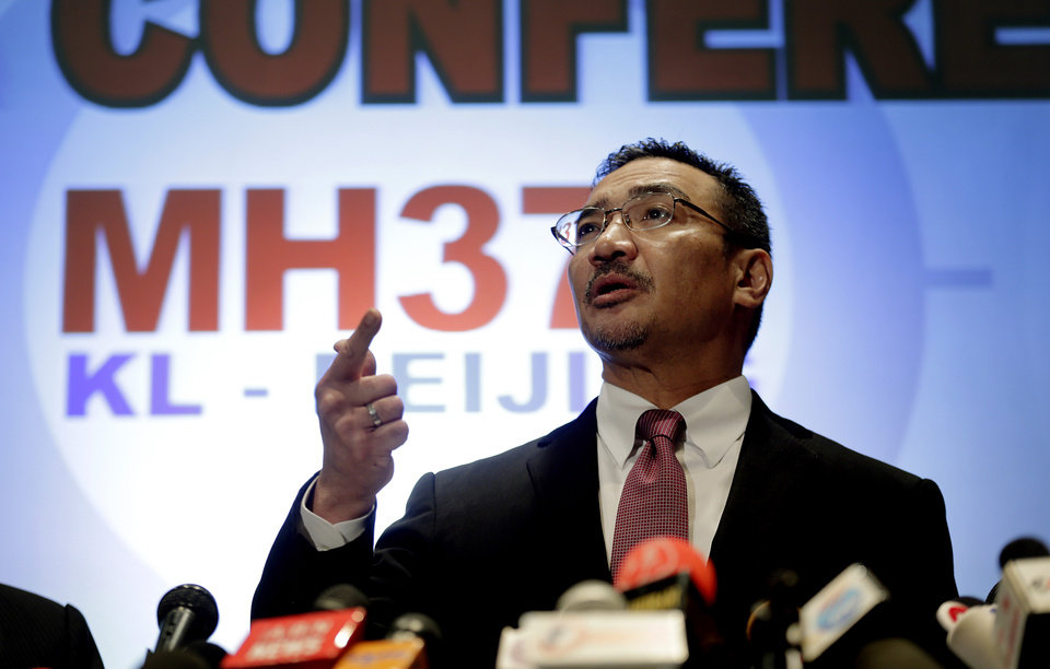 Photo - Malaysia's Minister of Transport Hishamuddin Hussein takes questions from the media during a press conference about the missing Malaysia Airlines jetliner MH370, Thursday, March 13, 2014, in Sepang, Malaysia. Planes sent Thursday to check the spot where Chinese satellite images showed possible debris from the missing Malaysian jetliner found nothing, Malaysia's civil aviation chief said, deflating the latest lead in the six-day hunt. The hunt for the missing Malaysia Airlines flight 370 has been punctuated by false leads since it disappeared with 239 people aboard about an hour after leaving Kuala Lumpur for Beijing early Saturday. (AP Photo/Wong Maye-E)