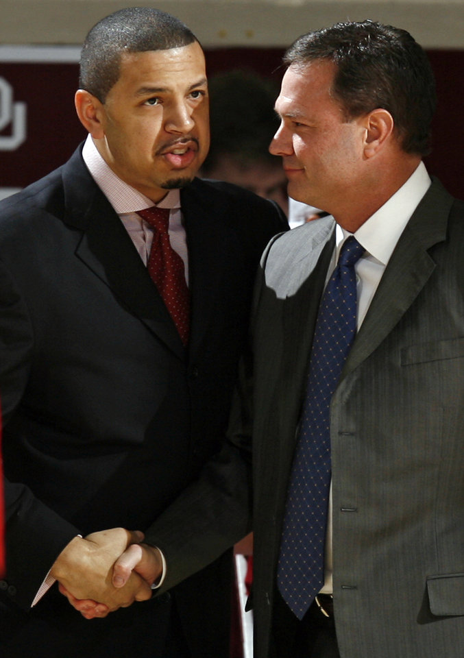 OU head coach Jeff Capel, left, and KU head coach Bill Self talk before the men's college basketball game between Kansas and Oklahoma at the Lloyd Noble Center in Norman, Okla., Monday, February 23, 2009. BY NATE BILLINGS, THE OKLAHOMAN