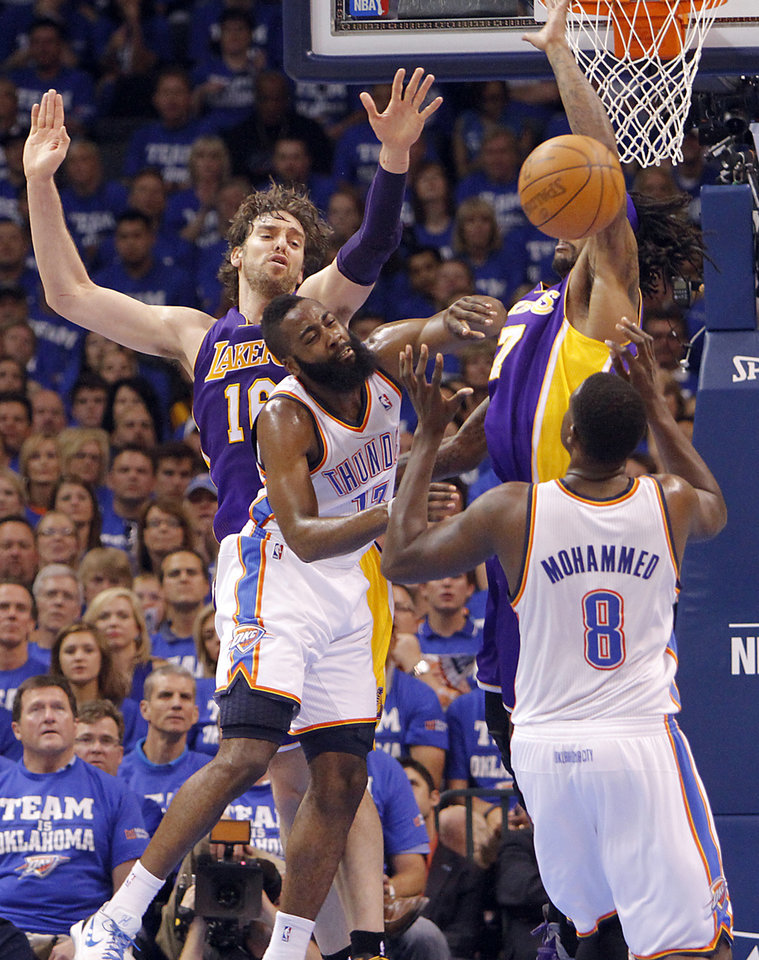 Photo - Oklahoma City's James Harden is fouled as he goes against Los Angeles' Pau Gasol and Jordan Hill during Game 2 in the second round of the NBA playoffs between the Oklahoma City Thunder and the L.A. Lakers at Chesapeake Energy Arena on Wednesday,  May 16, 2012, in Oklahoma City, Oklahoma. Photo by Chris Landsberger, The Oklahoman