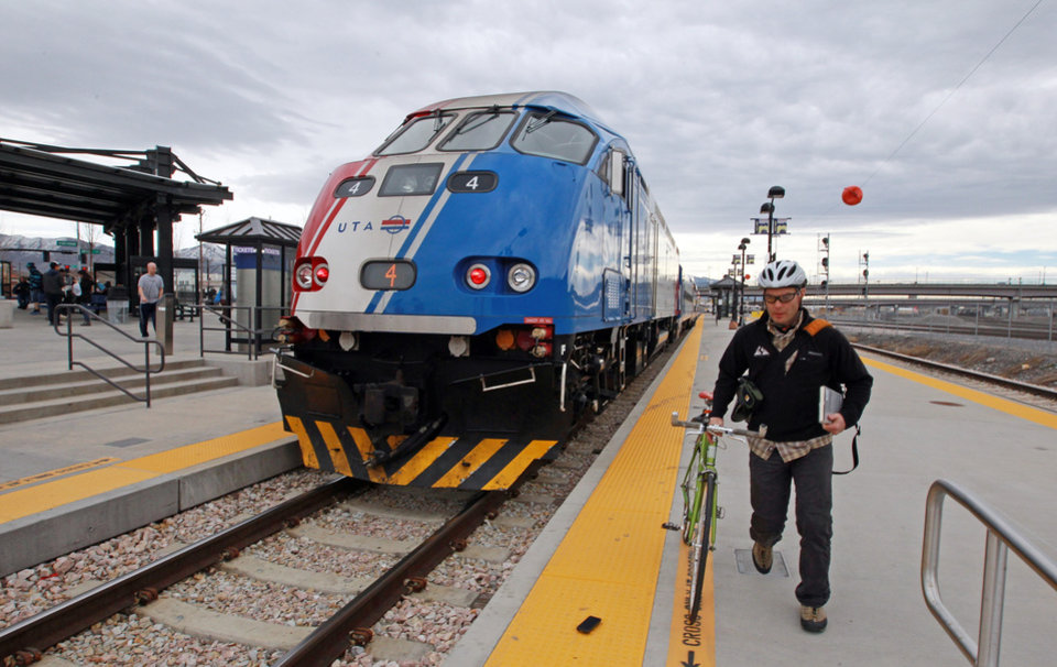 Photo - A commuters boards the