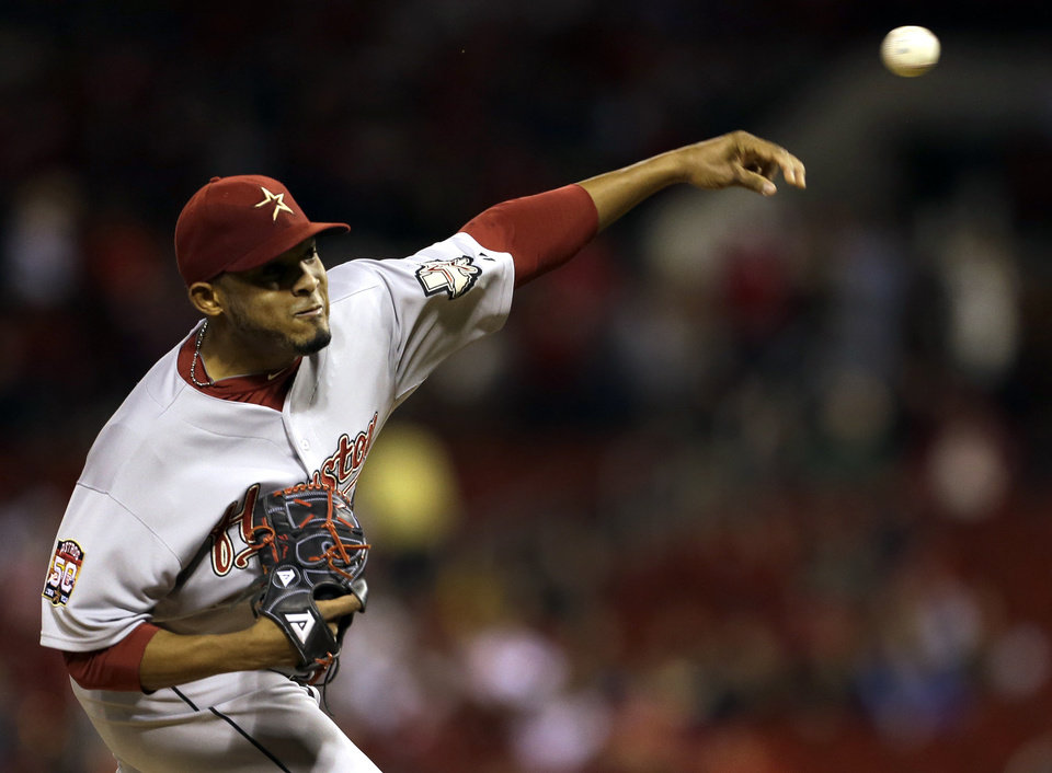 Photo -   Houston Astros starting pitcher Fernando Abad throws during the first inning of a baseball game against the St. Louis Cardinals, Tuesday, Sept. 18, 2012, in St. Louis. (AP Photo/Jeff Roberson)