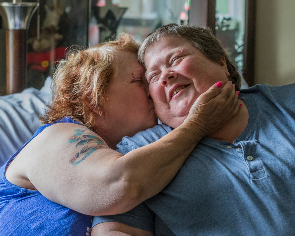 Photo - Lyn Judkins (left) kisses her partner or 13 years, Bonnie Everly reflecting on what today's court decision means to them in Chesterton on June 25, 2014. (AP Photo/Sun-Times Media, Jim Karczewski) MANDATORY CREDIT, MAGS OUT, NO SALES