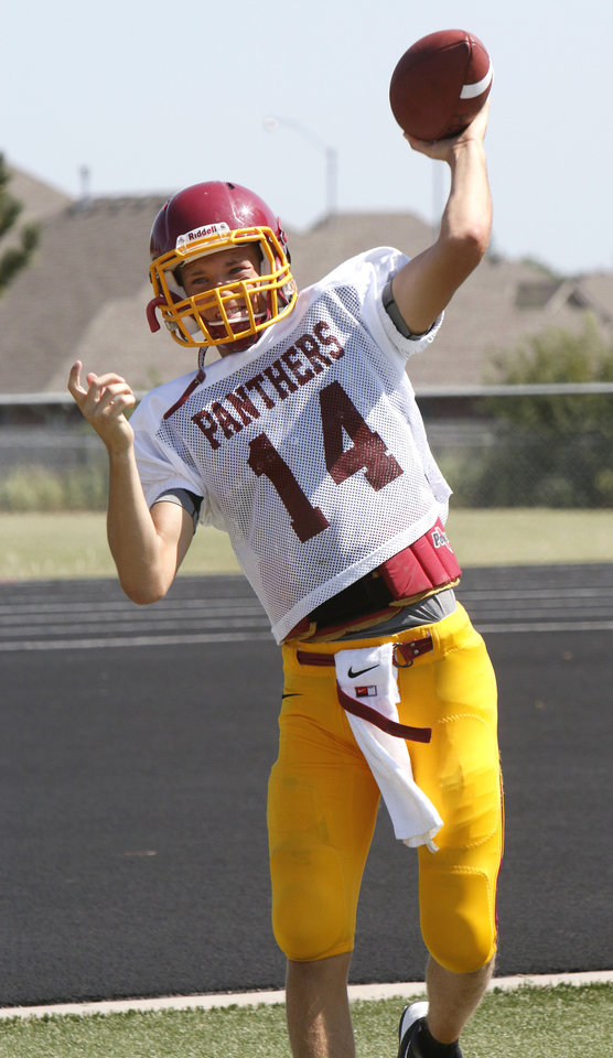Photo - Quarterback Chase Sparks throws the ball during morning practice at Putnam City North High School in Oklahoma City, OK, Monday, August 18, 2014,  Photo by Paul Hellstern, The Oklahoman