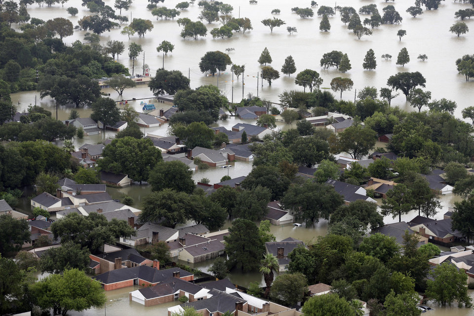 Photo - Homes are flooded near the Addicks Reservoir as floodwaters from Tropical Storm Harvey rise Tuesday, Aug. 29, 2017, in Houston. (AP Photo/David J. Phillip)