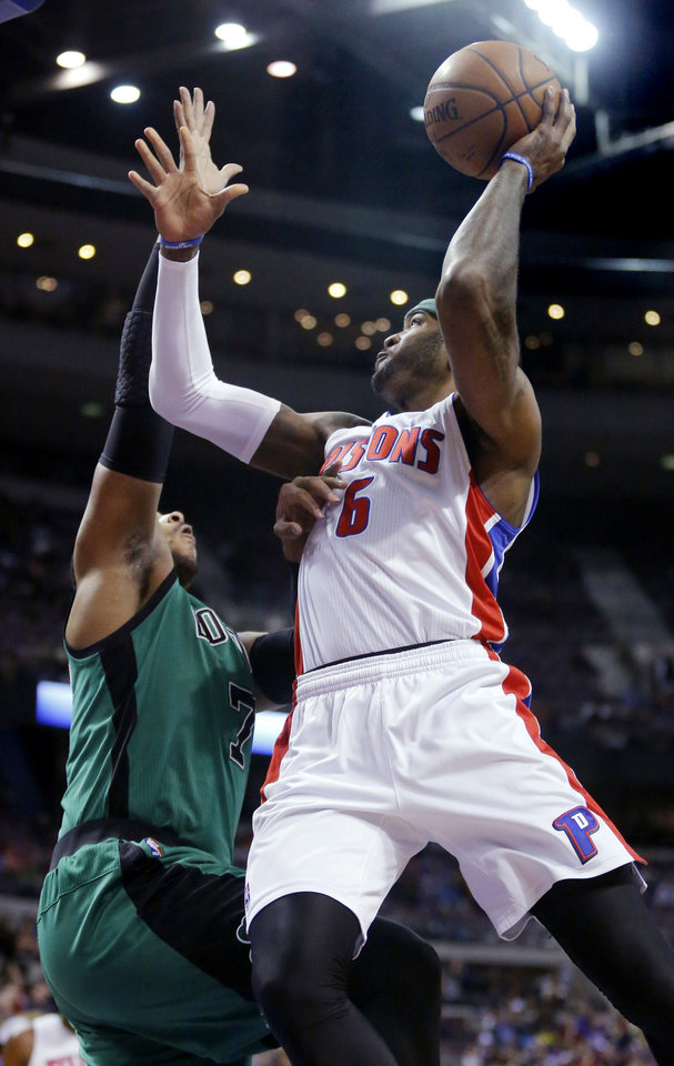 Photo - Detroit Pistons forward Josh Smith (6) goes to the basket against Boston Celtics forward Jared Sullinger during the first half of an NBA basketball game Saturday, April 5, 2014, in Auburn Hills, Mich. (AP Photo/Duane Burleson)