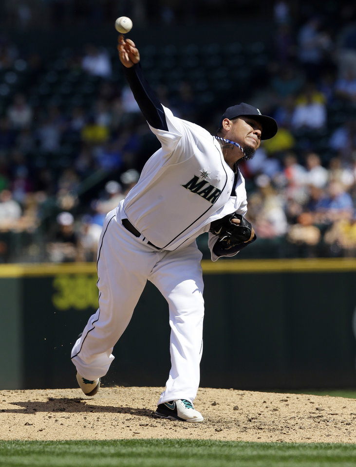 Photo - Seattle Mariners starting pitcher Felix Hernandez throws in the fourth inning of a baseball game against the Milwaukee Brewers, Sunday, Aug. 11, 2013, in Seattle. (AP Photo/Ted S. Warren)