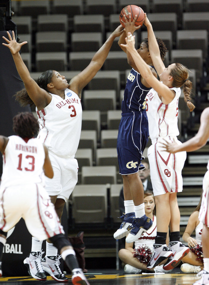 Photo - Courtney Paris and Whitney hand combine to block a shot by Deja Foster in the first half as the University of Oklahoma (OU) plays Georgia Tech in round two of the 2009 NCAA Division I Women's Basketball Tournament at Carver-Hawkeye Arena at the University of Iowa in Iowa City, IA on Tuesday, March 24, 2009. 